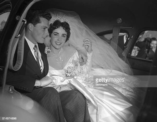 Actress Elizabeth Taylor and her groom Conrad 'Nickie' Hilton Jr in the limousine that will take them to their wedding reception at the BelAir...