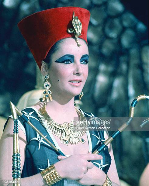 Actress Elizabeth Taylor as the titular Queen of Egypt in the film 'Cleopatra' 1963 She is holding the crook and flail which signify Egyptian royalty