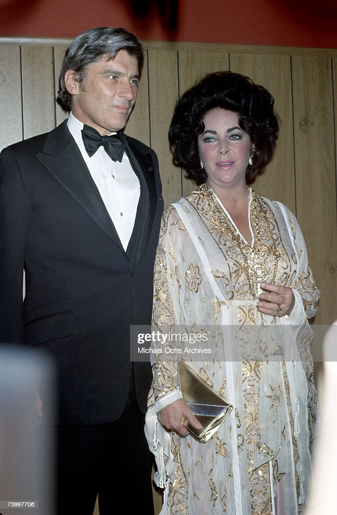 Actress Elizabeth Taylor attends a press conference with her husband politician John Warner in circa 1978 in Los Angeles, California.