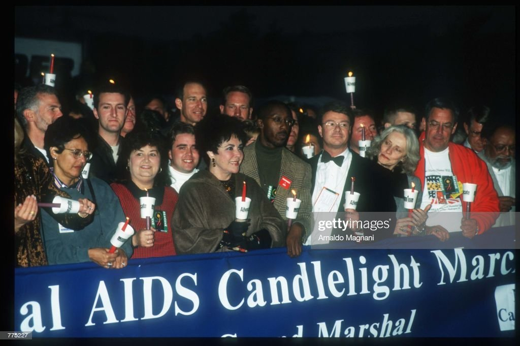 Actress Elizabeth Taylor holds a candle at an AIDS quilt vigil October 12 1996 in Washington DC Taylor led a candlelight march of more than 150000...