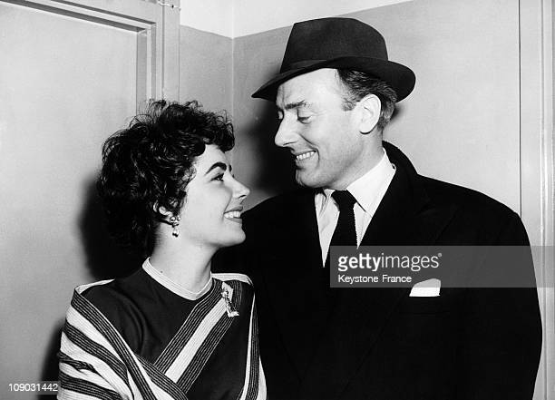Actress Elizabeth Taylor is welcomed by her fiance Michael Wilding at a London Airport on February 20 1952 in London England