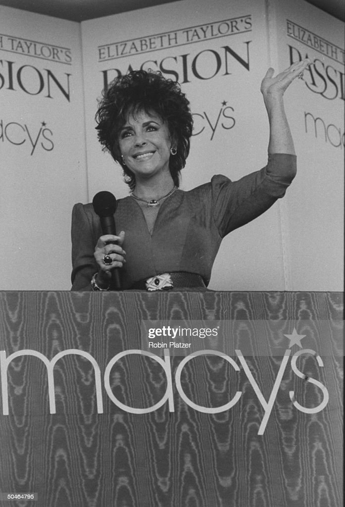 Actress Elizabeth Taylor waving during a promotional appearance for her perfume Elizabeth Taylor's Passion at a Macy's department store.
