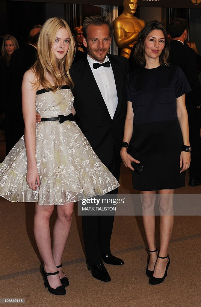 Actress Elle Fanning, actor Stephen Dorff and director Sofia Coppola arrive on the red carpet for the 2010 Oscars Governors Awards at the Hollywood and Highland Center in Hollywood on November 13, 2010. AFP PHOTO / Mark RALSTON