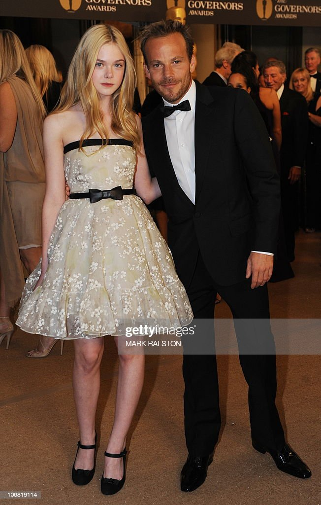 Actress Elle Fanning and actor Stephen Dorff arrive on the red carpet for the 2010 Oscars Governors Awards at the Hollywood and Highland Center in Hollywood on November 13, 2010. AFP PHOTO / Mark RALSTON