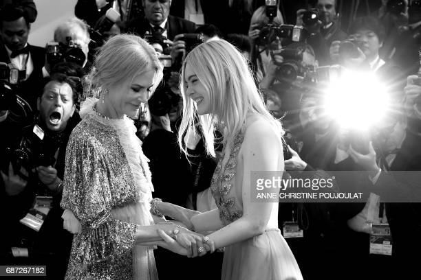 US actress Elle Fanning and Australian actress Nicole Kidman leave on May 21 2017 following the screening of the film 'How to talk to Girls at...