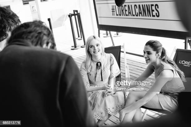 Actress Elle Fanning and Deepika Padukone are photographed in the L'Oreal Paris beach studio on May 18 2017 in Cannes France