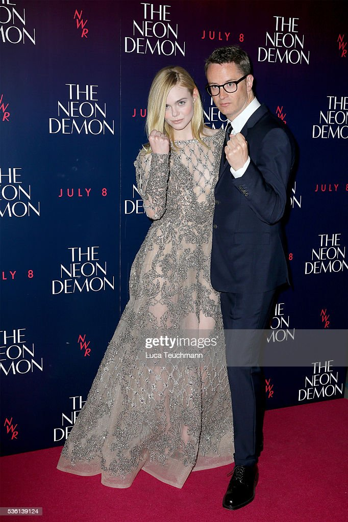 Actress <a gi-track='captionPersonalityLinkClicked' href=/galleries/search?phrase=Elle+Fanning&family=editorial&specificpeople=2189940 ng-click='$event.stopPropagation()'>Elle Fanning</a> and director <a gi-track='captionPersonalityLinkClicked' href=/galleries/search?phrase=Nicolas+Winding+Refn&family=editorial&specificpeople=5498587 ng-click='$event.stopPropagation()'>Nicolas Winding Refn</a> attend 'The Neon Demon' UK premiere at the Picturehouse Central on May 31, 2016 in London, England.