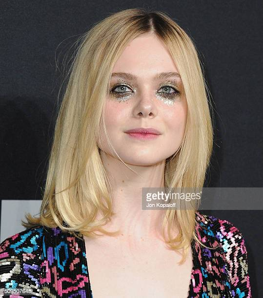 Actress Elle Fanning arrives at SAINT LAURENT At The Palladium at Hollywood Palladium on February 10 2016 in Los Angeles California