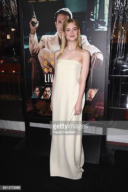 Actress Elle Fanning arrives at the Premiere Of Warner Bros Pictures' 'Live By Night' at TCL Chinese Theatre on January 9 2017 in Hollywood California