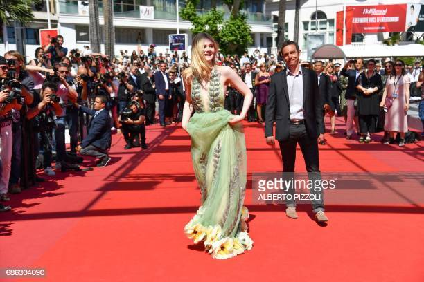 US actress Elle Fanning arrives on May 21 2017 for the screening of the film 'How to talk to Girls at Parties' at the 70th edition of the Cannes Film...