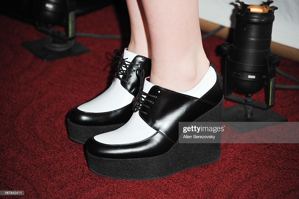 Actress <a gi-track='captionPersonalityLinkClicked' href=/galleries/search?phrase=Elle+Fanning&family=editorial&specificpeople=2189940 ng-click='$event.stopPropagation()'>Elle Fanning</a> (shoe detail) attends the AMPAS Academy Nicholl Fellowships in Screenwriting Awards at AMPAS Samuel Goldwyn Theater on November 7, 2013 in Beverly Hills, California.
