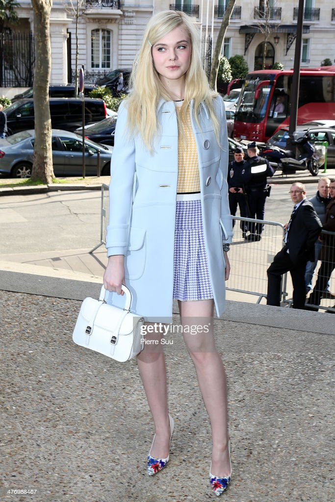Actress <a gi-track='captionPersonalityLinkClicked' href=/galleries/search?phrase=Elle+Fanning&family=editorial&specificpeople=2189940 ng-click='$event.stopPropagation()'>Elle Fanning</a> attends the Miu Miu show as part of the Paris Fashion Week Womenswear Fall/Winter 2014-2015 on March 5, 2014 in Paris, France. on March 5, 2014 in Paris, France.