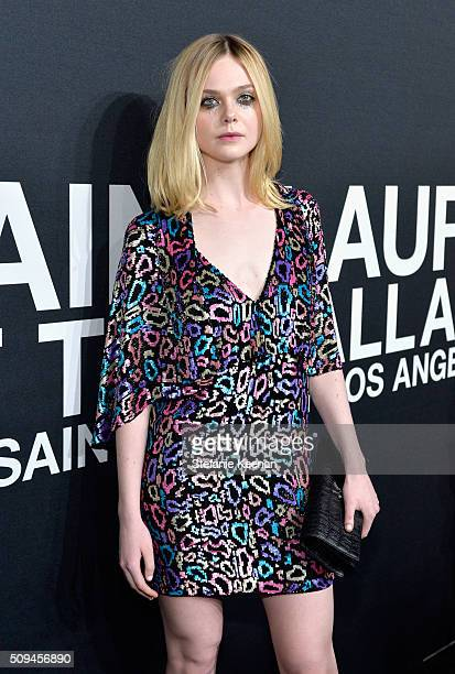 Actress Elle Fanning in Saint Laurent by Hedi Slimane attends Saint Laurent at the Palladium on February 10 2016 in Los Angeles California for the...