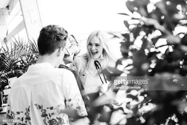 Actress Elle Fanning meets with fans in the L'Oreal Paris beach studio on May 18 2017 in Cannes France