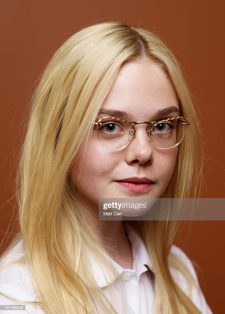 Actress <a gi-track='captionPersonalityLinkClicked' href=/galleries/search?phrase=Elle+Fanning&family=editorial&specificpeople=2189940 ng-click='$event.stopPropagation()'>Elle Fanning</a> of 'Ginger And Rosa' poses at the Guess Portrait Studio during 2012 Toronto International Film Festival on September 7, 2012 in Toronto, Canada.