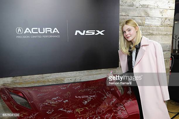 Actress Elle Fanning of 'Sidney Hall' signs the hood of a 2017 Acura NSX in the Acura Studio during Sundance Film Festival 2017 on January 23 2017 in...