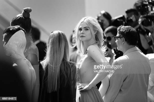 US actress Elle Fanning poses as she arrives on May 21 2017 for the screening of the film 'How to talk to Girls at Parties' at the 70th edition of...