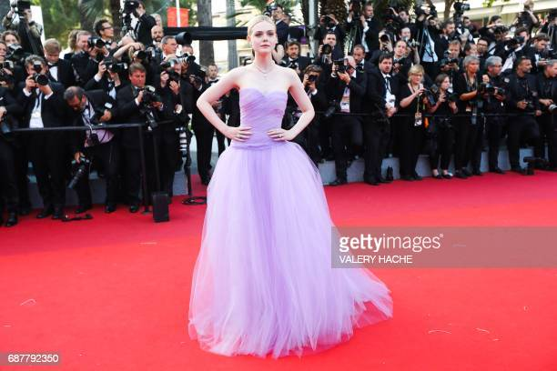 US actress Elle Fanning poses as she arrives on May 24 2017 for the screening of the film 'The Beguiled' at the 70th edition of the Cannes Film...
