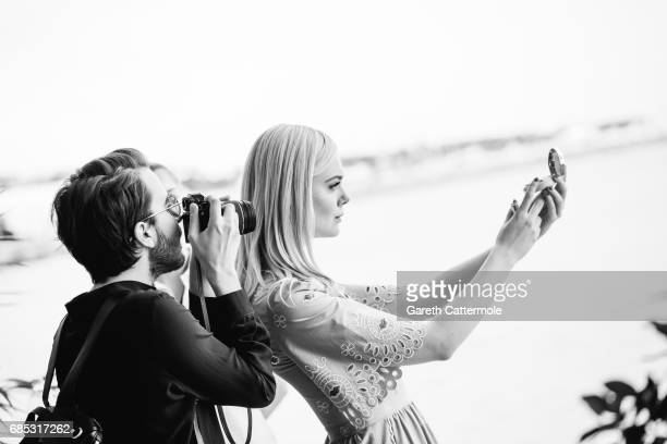 Actress Elle Fanning poses at the L'Oreal Paris beach studio on May 18 2017 in Cannes France
