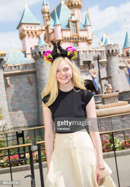 Actress Elle Fanning visits Disneyland on April 12 2014 in Anaheim California
