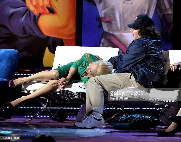 Actress Ellen Barkin and comedian Jeffrey Ross speak onstage during the Comedy Central Roast of Roseanne Barr at Hollywood Palladium on August 4 2012...