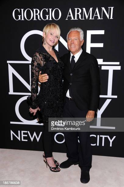 Actress Ellen Barkin wearing Armani and fashion designer Giorgio Armani attend Giorgio Armani One Night Only NYC at SuperPier on October 24 2013 in...