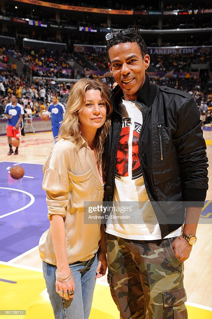 Actress Ellen Pompeo and her husband Chris Ivery pose for a photograph at halftime of a game between the Los Angeles Clippers and the Los Angeles Lakers at Staples Center on February 14, 2013 in Los Angeles, California.