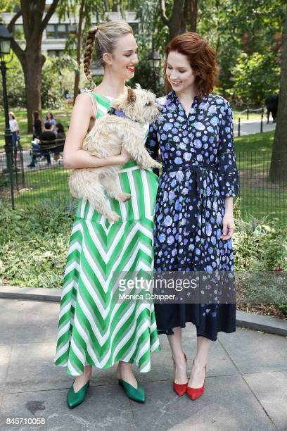 Actress Ellie Kemper poses for a photo with a model and Lela Rose's dog Bobbin at the Lela Rose Presentation during New York Fashion Week at...