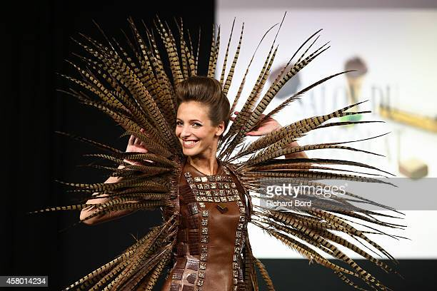 Actress Elodie Varlet walks the runway and wears a chocolate dress made by stylist Lauranne De Jaegher and chocolate makers JeanPhilippe Darcis...