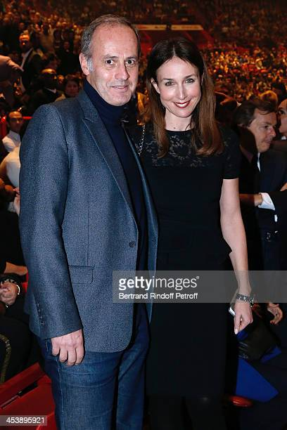 Actress Elsa Zylberstein and CEO of group Conde Nast France Xavier Romatet attending Celine Dion's Concert at Palais Omnisports de Bercy on December...