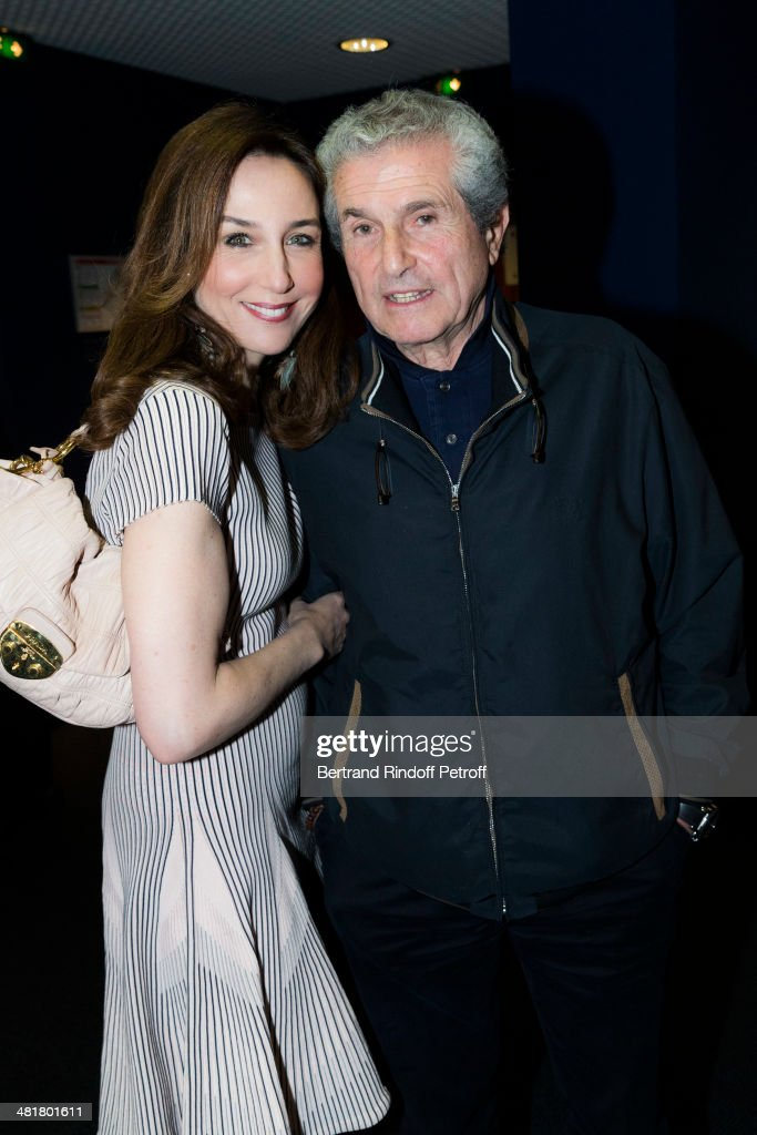 Actress Elsa Zylberstein (L) and director Claude Lelouch pose during the premiere of 'Salaud, on t'aime' (Bastard, we love you) directed by French director Claude Lelouch at Cinema UGC Normandie on March 31, 2014 in Paris, France.