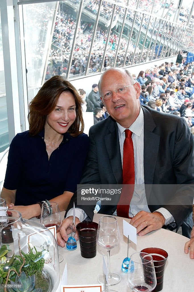 Actress Elsa Zylberstein and President of France Television Remy Pflimlin attend the 2015 Roland Garros French Tennis Open - Day Nine on June 1, 2015 in Paris, France.