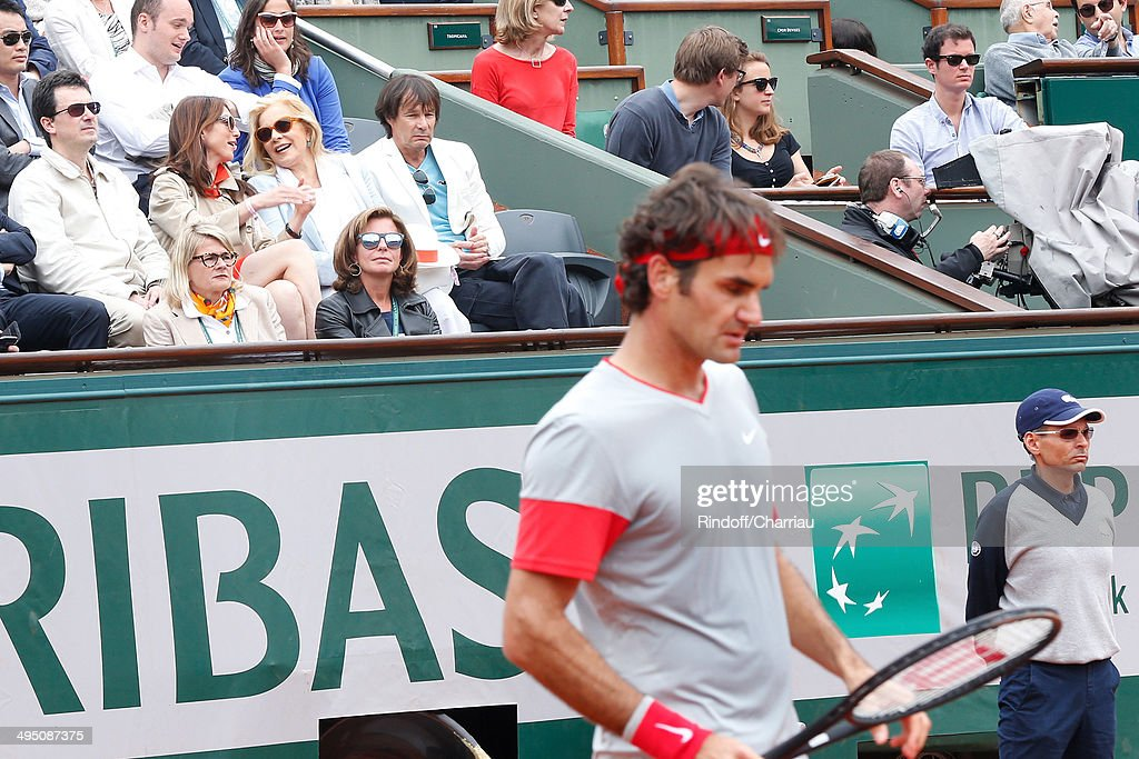 Actress Elsa Zylberstein and singer Sylvie Vartan watches Roger Federer match at the Roland Garros French Tennis Open 2014 - Day 8 on June 1, 2014 in Paris, France.
