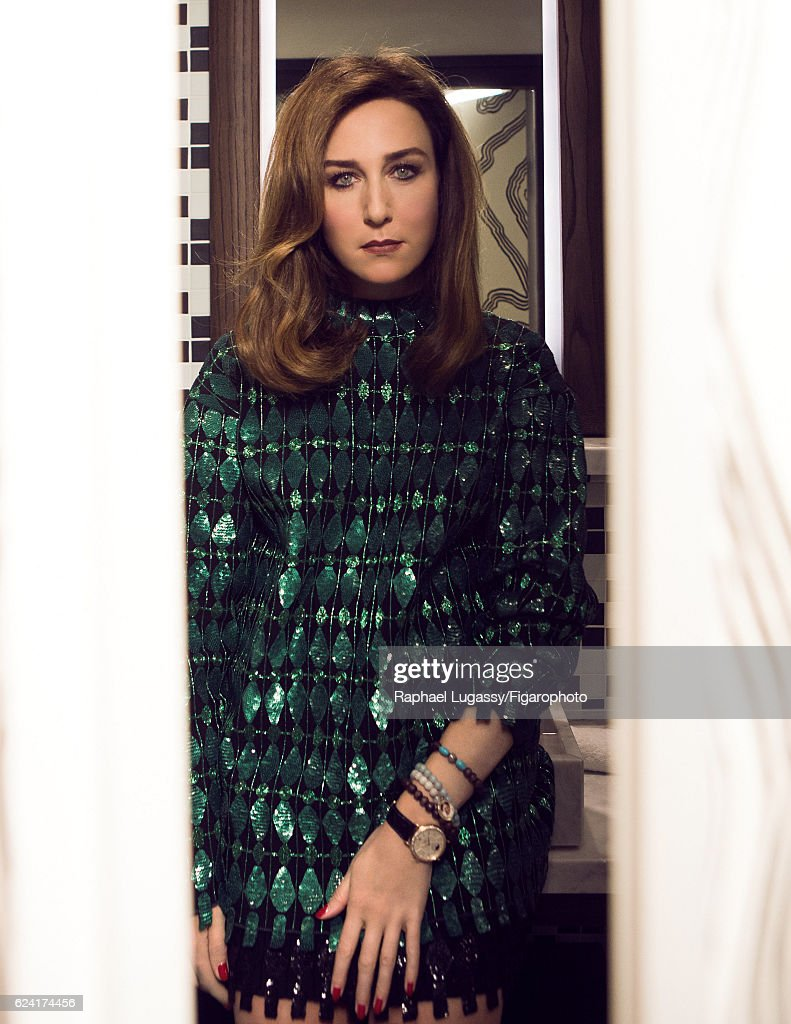 Actress Elsa Zylberstein is photographed for Madame Figaro on October 13, 2016 in Paris, France. Sweater and skirt (Alaia), watch and jewelry personal. PUBLISHED IMAGE.