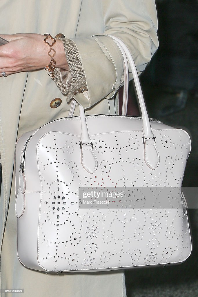 Actress <a gi-track='captionPersonalityLinkClicked' href=/galleries/search?phrase=Elsa+Zylberstein&family=editorial&specificpeople=213054 ng-click='$event.stopPropagation()'>Elsa Zylberstein</a> (handbag detail) is seen at Nice airport during the 66th Annual Cannes Film Festival on May 22, 2013 in Nice, France.
