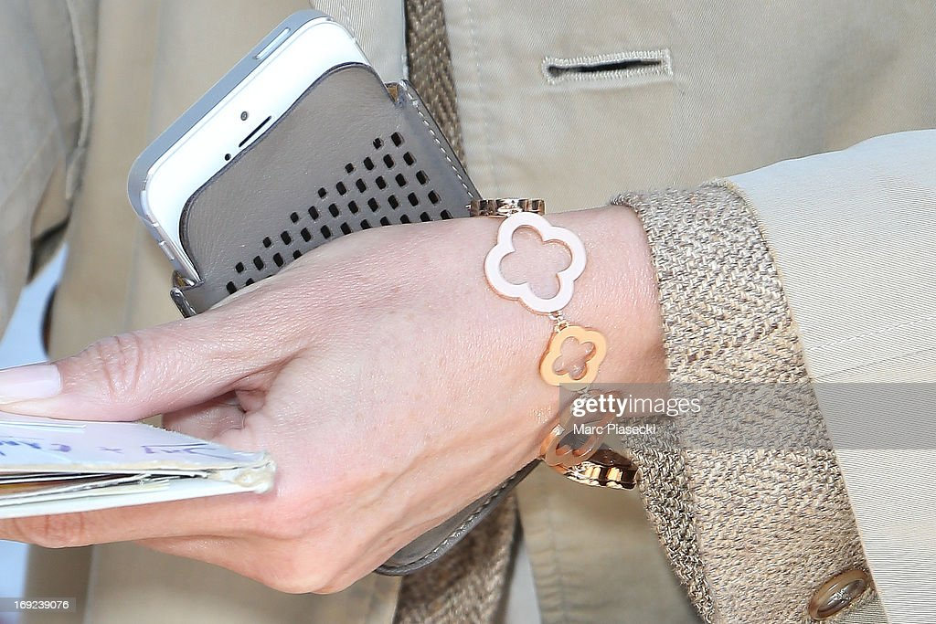 Actress <a gi-track='captionPersonalityLinkClicked' href=/galleries/search?phrase=Elsa+Zylberstein&family=editorial&specificpeople=213054 ng-click='$event.stopPropagation()'>Elsa Zylberstein</a> (bracelet detail) is seen at Nice airport during the 66th Annual Cannes Film Festival on May 22, 2013 in Nice, France.