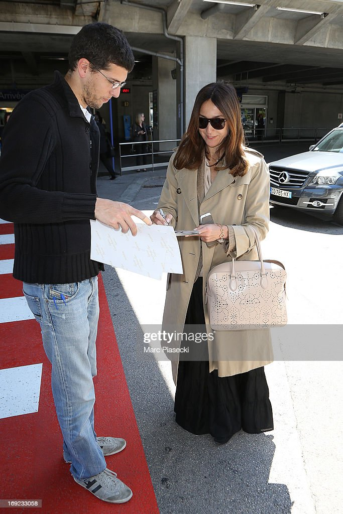 Actress <a gi-track='captionPersonalityLinkClicked' href=/galleries/search?phrase=Elsa+Zylberstein&family=editorial&specificpeople=213054 ng-click='$event.stopPropagation()'>Elsa Zylberstein</a> signs autographs as she is seen at Nice airport during the 66th Annual Cannes Film Festival on May 22, 2013 in Nice, France.
