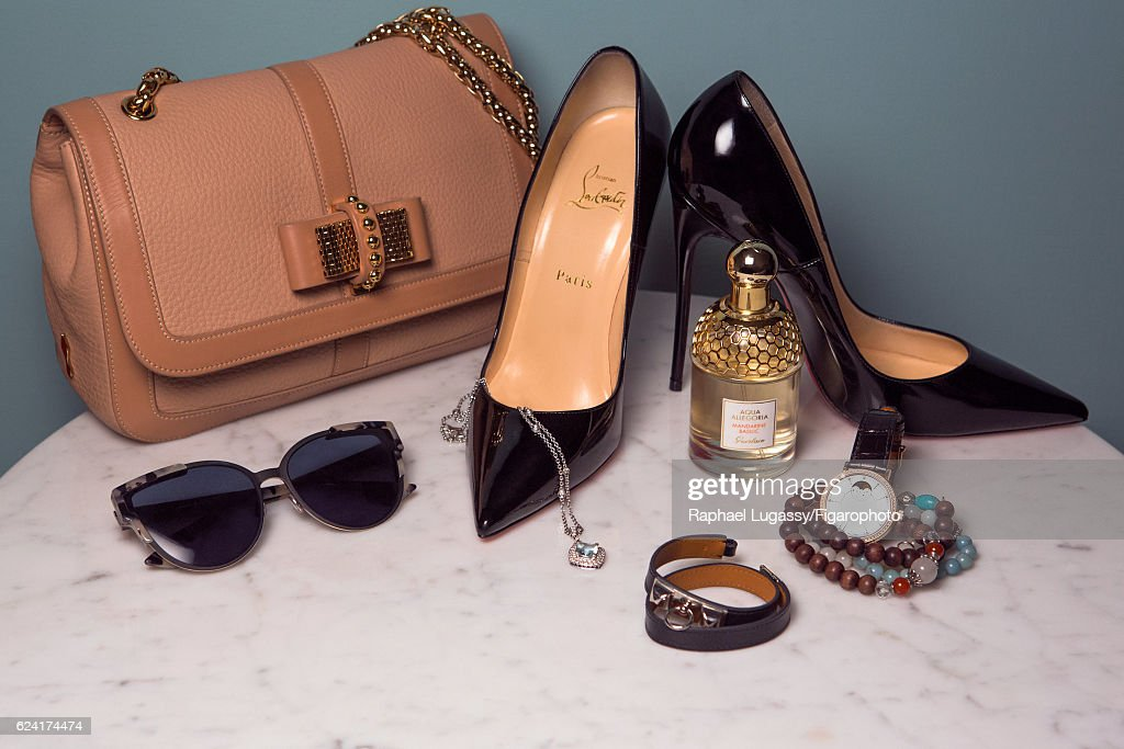 Actress Elsa Zylberstein's style inspirations are photographed for Madame Figaro on October 13, 2016 in Paris, France. Bag and shoes (Christian Louboutin), sunglasses (Lagerfeld), bracelet (Hermes), necklace (Mauboussin), bracelets personal, watch (IWC), perfume (Guerlain). PUBLISHED IMAGE.