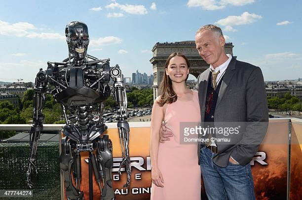 Actress Emilia Clarke and Director Alan Taylor pose with Endoskeleton during the France Photocall of 'Terminator Genisys' at the Publicis Champs...