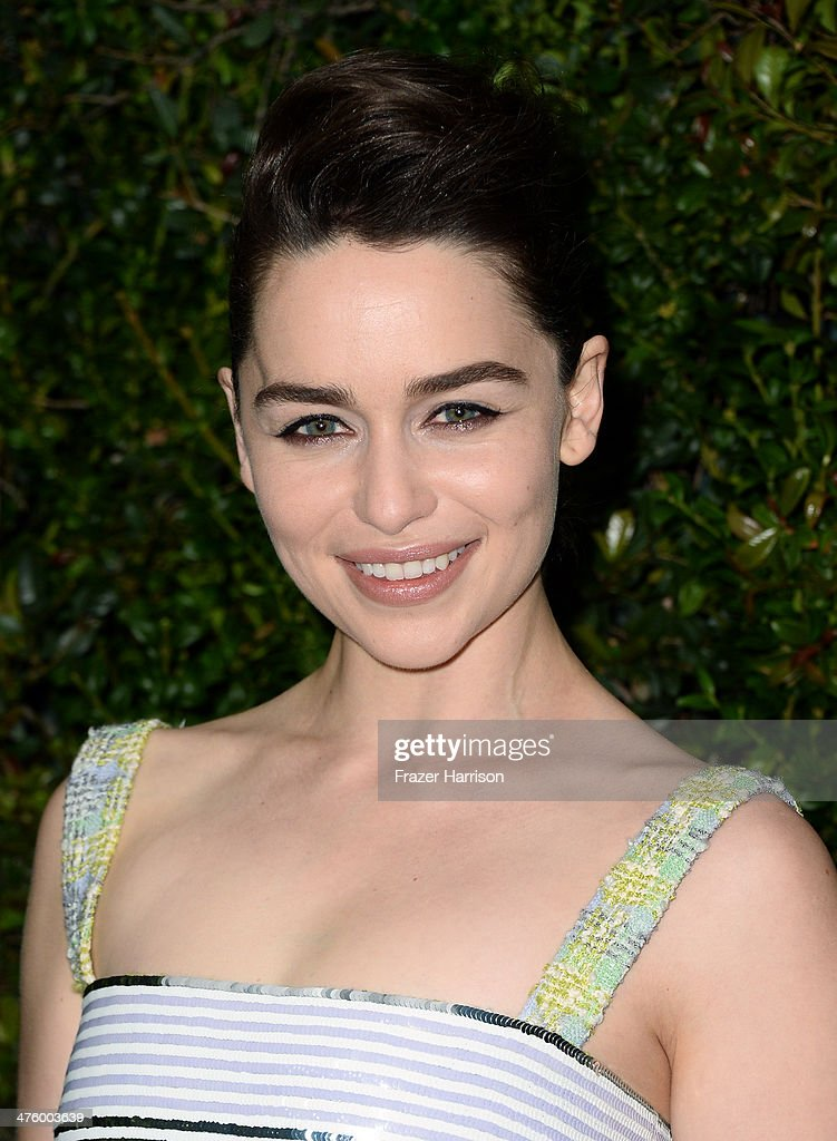 Actress Emilia Clarke attends the Chanel and Charles Finch PreOscar Dinner at Madeo Restaurant on March 1 2014 in Los Angeles California
