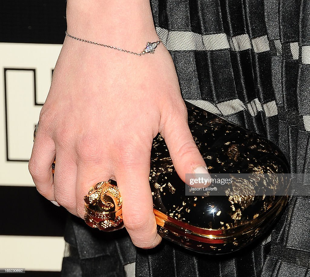 Actress Emilia Clarke (handbag and jewelry detail) attends the HBO after party at the 70th annual Golden Globe Awards at Circa 55 restaurant at the Beverly Hilton Hotel on January 13, 2013 in Los Angeles, California.