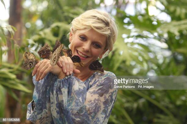 Actress Emilia Fox holds butterflies in the RHS Butterfly Dome with Eden at the RHS Hampton Court Palace Flower Show East Molesey Surrey