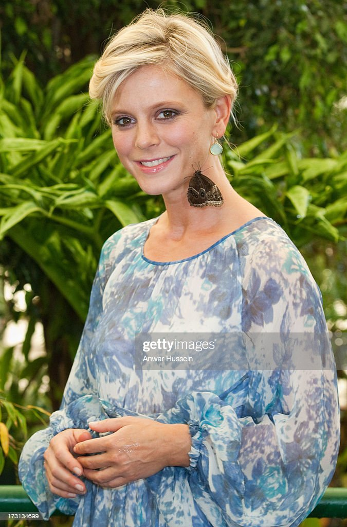 Actress Emilia Fox poses with butterflies in the RHS Butterfly Dome with Eden at the RHS Hampton Court Flower Show on July 8, 2013 in London, England.