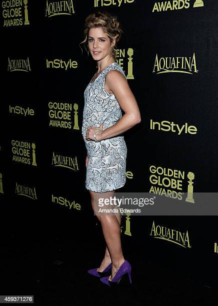 Actress Emily Bett Rickards arrives at The Hollywood Foreign Press Association and InStyle's 2015 Golden Globe Award Season celebration at Fig Olive...