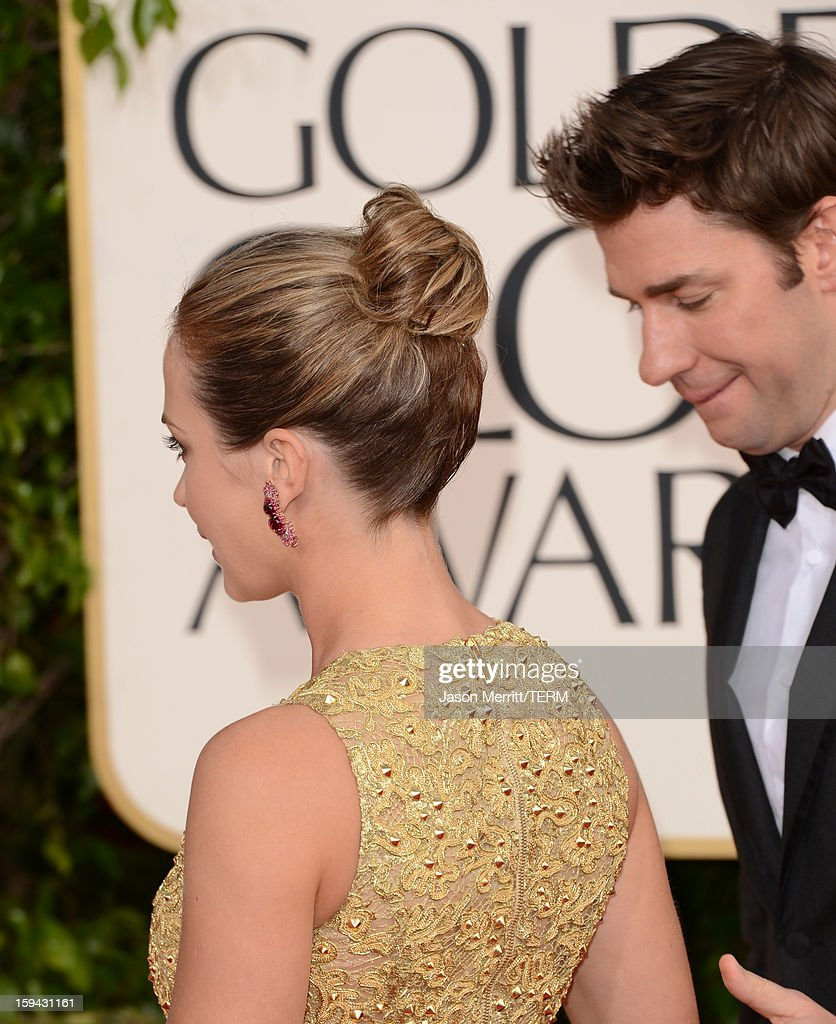 Actress Emily Blunt (L) and actor John Krasinski arrive at the 70th Annual Golden Globe Awards held at The Beverly Hilton Hotel on January 13, 2013 in Beverly Hills, California.