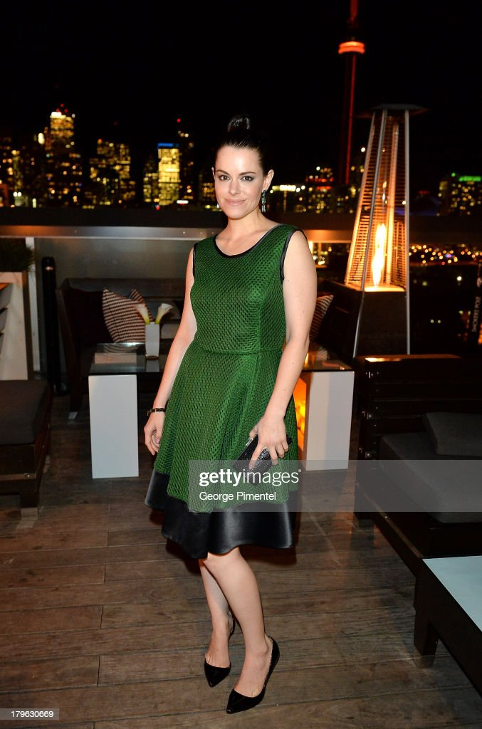 Actress <a gi-track='captionPersonalityLinkClicked' href=/galleries/search?phrase=Emily+Hampshire&family=editorial&specificpeople=769584 ng-click='$event.stopPropagation()'>Emily Hampshire</a> attends the Interview Magazine, Sundance Selects and Mongrel Media celebrate the TIFF premiere screening of 'Blue is the Warmest Color' during 2013 Toronto International Film Festival on September 5, 2013 in Toronto, Canada.