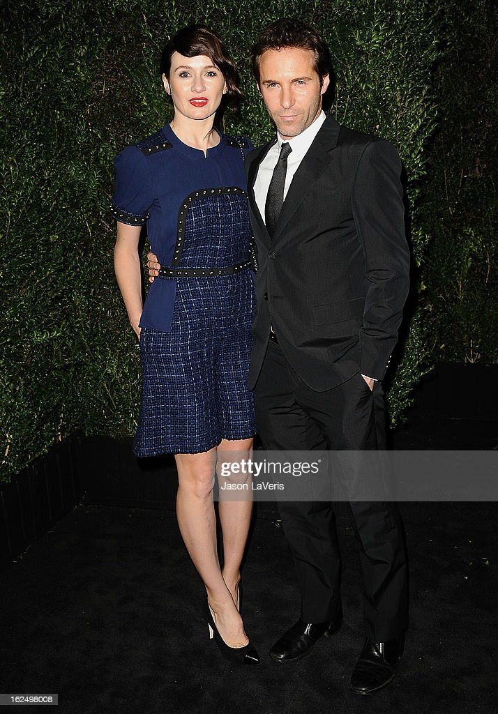 Actress Emily Mortimer and actor Alessandro Nivola attend the Chanel Pre-Oscar dinner at Madeo Restaurant on February 23, 2013 in Los Angeles, California.
