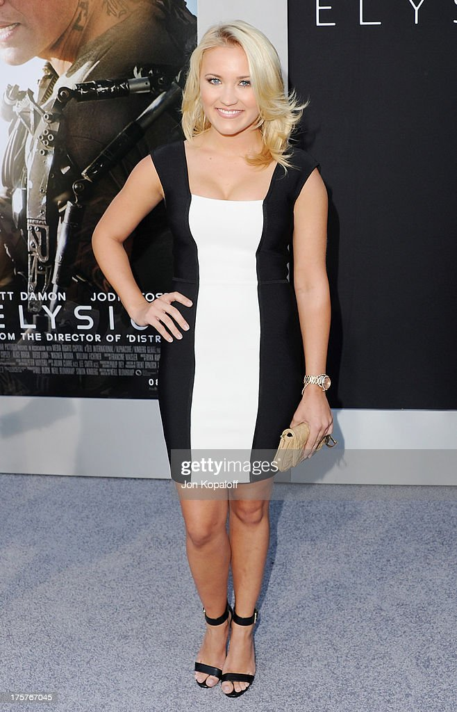 Actress <a gi-track='captionPersonalityLinkClicked' href=/galleries/search?phrase=Emily+Osment&family=editorial&specificpeople=873997 ng-click='$event.stopPropagation()'>Emily Osment</a> arrives at the Los Angeles Premiere 'Elysium' at Regency Village Theatre on August 7, 2013 in Westwood, California.