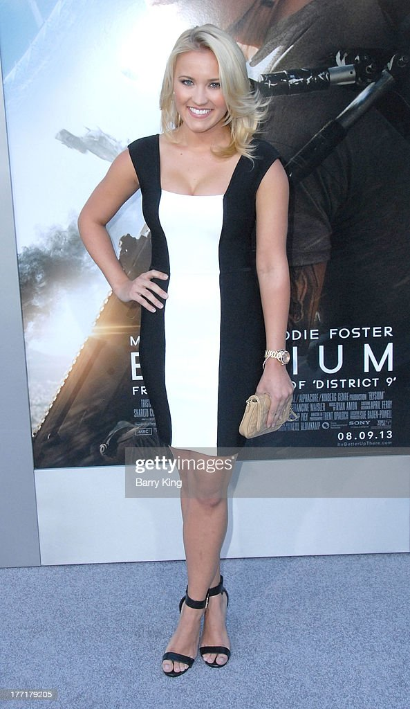 Actress Emily Osment arrives at the Los Angeles Premiere of 'Elysium' on August 7, 2013 at Regency Village Theatre in Westwood, California.