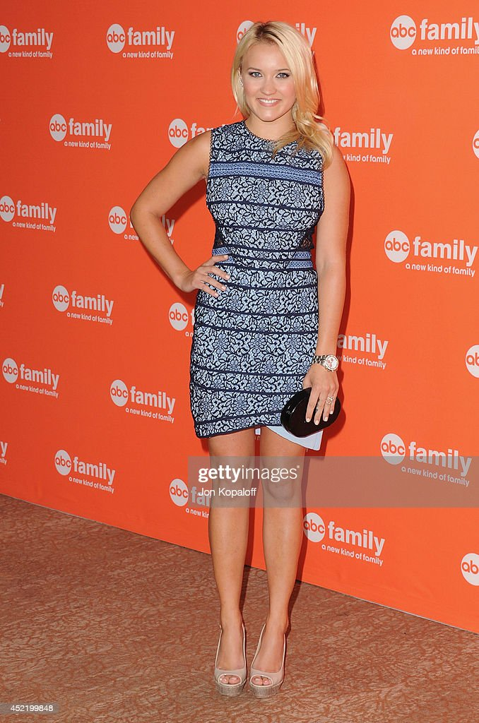 Actress <a gi-track='captionPersonalityLinkClicked' href=/galleries/search?phrase=Emily+Osment&family=editorial&specificpeople=873997 ng-click='$event.stopPropagation()'>Emily Osment</a> arrives the Disney|ABC Television Group 2014 Television Critics Association Summer Press Tour at The Beverly Hilton Hotel on July 15, 2014 in Beverly Hills, California.